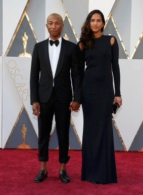 Singer Pharrell Williams and wife Helen Lasichanh arrive at the 88th Academy Awards in Hollywood, California February 28, 2016. REUTERS/Lucy Nicholson